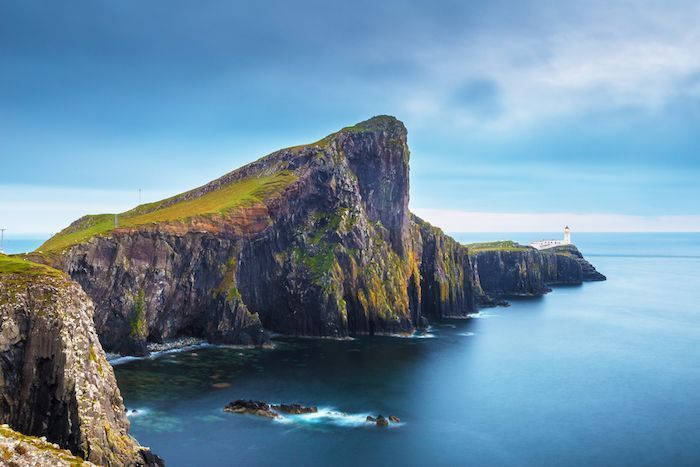 Neist Point and the lighthouse on Isle of Skye before sunset - Scotland, UK. By ZGPhotography | Shutterstock.com