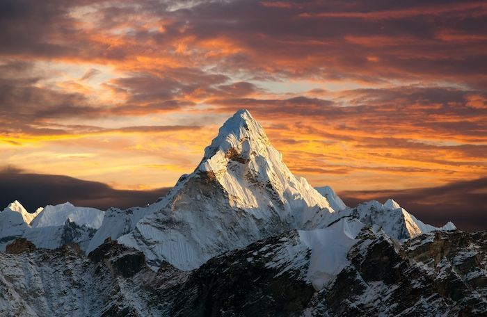Evening panoramic view of mount Ama Dablam with beautiful sky on the way to Everest base camp, Khumbu valley, Sagarmatha national park, Everest area, Nepal. By Daniel Prudek | Shutterstock.com